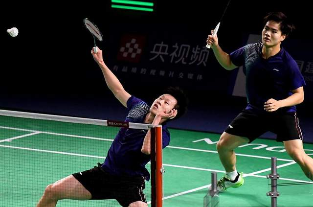 任翔宇(左)/梁伟铿在比赛中